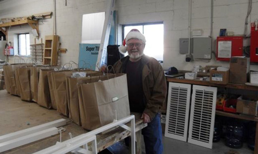"""Ed """"Santa Claus"""" Peters on his way to deliver thank you gifts to the best concierges and doormen"""